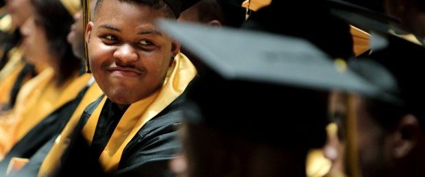 Darreontae Martin laughs with his classmates during the graduation ceremony for Sheffield High School at the Orpheum Theatre in Memphis, Tenn. on Sunday, May 20, 2012. Martin, a former football player at Sheffield who was struck by two drag-racing cars while crossing the street in May 2011, achieved his goal of walking across the stage to get his diploma without the use of a cane. (AP Photo/The Commercial Appeal, Mike Brown)